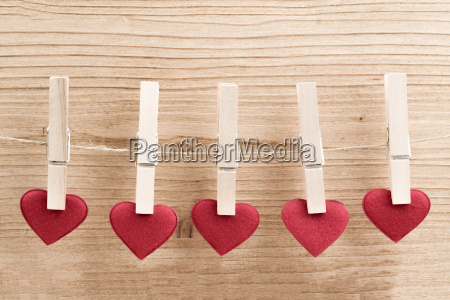 red fabric heart hanging on the