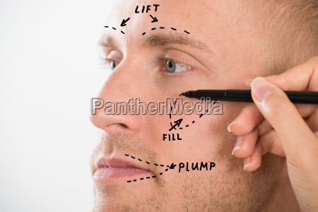 mans face with correction line drawn