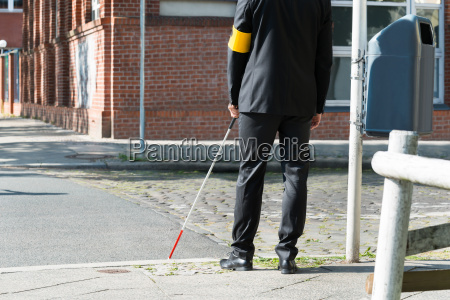 blind man with white stick on