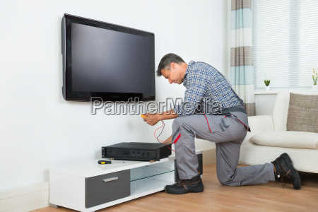 technician installing tv set top box