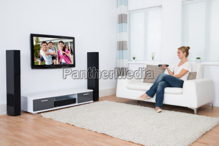 woman watching television while sitting on