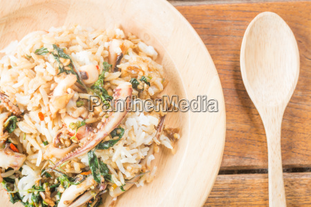 rice topped with stir fried squid