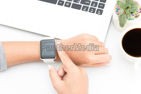 woman touching smart watch hand on
