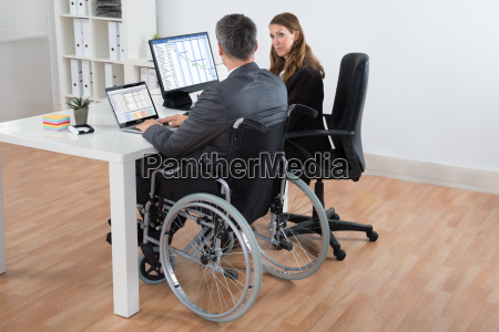 businessman and businesswoman working on computer