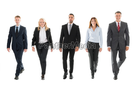 confident business people walking against white