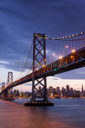 dusk over bay bridge and san