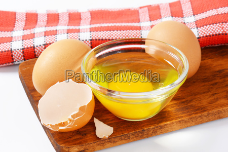 egg white and yolk in glass