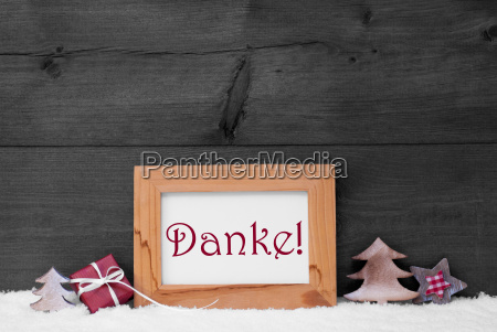 gray frame with christmas decoration snow