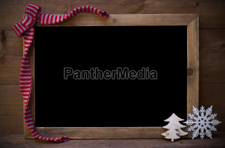 chalkboard with christmas decoration and copy