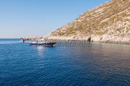 motorboat moored at porto vromi