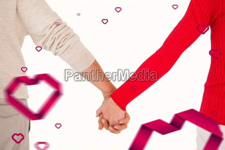 composite image of couple holding hands