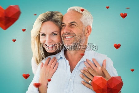 composite image of smiling couple embracing