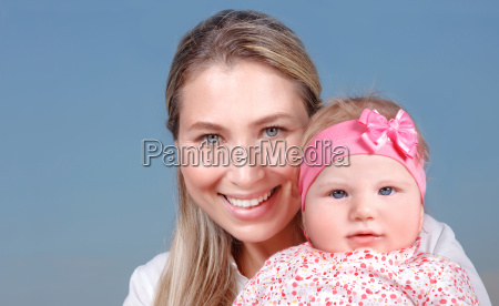 happy mother with little baby