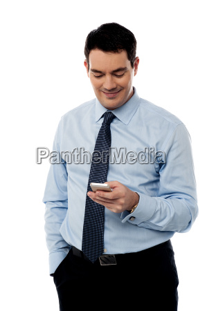 corporate guy sending emails from phone