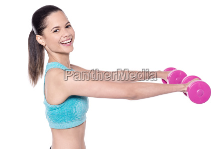 slim young lady enjoying workout