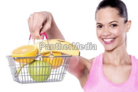 woman holding mini fruits basket