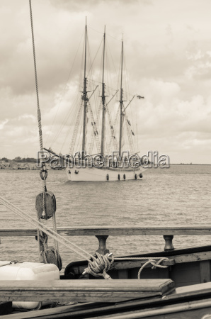 old sailboat in the harbor sepia