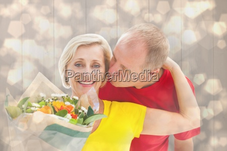 composite image of mature man kissing
