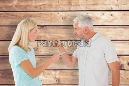 composite image of unhappy couple having