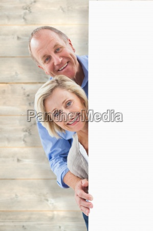 composite image of mature couple smiling