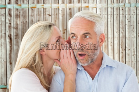 composite image of woman whispering a