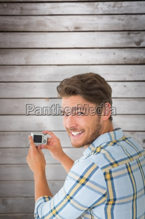 composite image of man taking photo