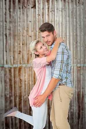 composite image of handsome man hugging