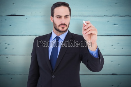 composite image of businessman holding a