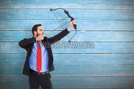 composite image of focused businessman shooting