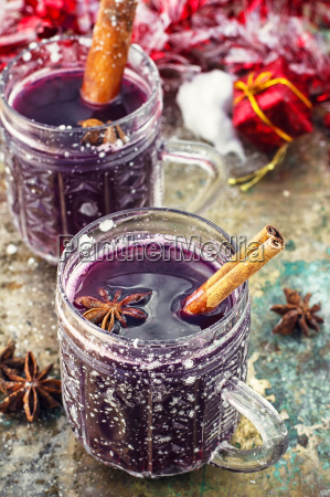 glass of mulled wine and spices