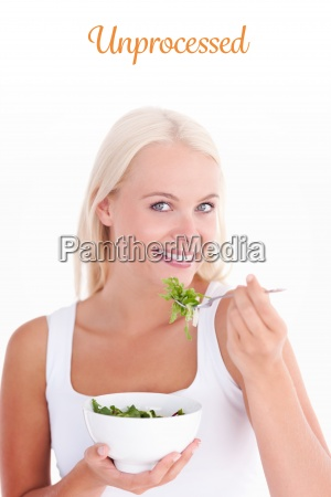 unprocessed against smiling woman eating salad
