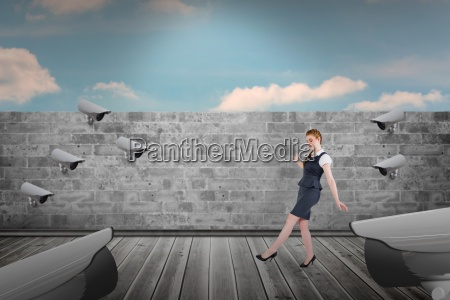 composite image of businesswoman doing a