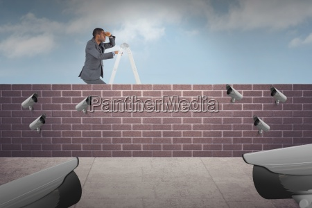 composite image of businessman standing on
