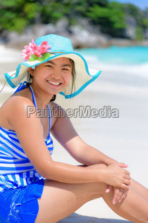 happy girl on the beach at