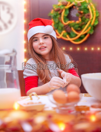 little girl cooking for christmas