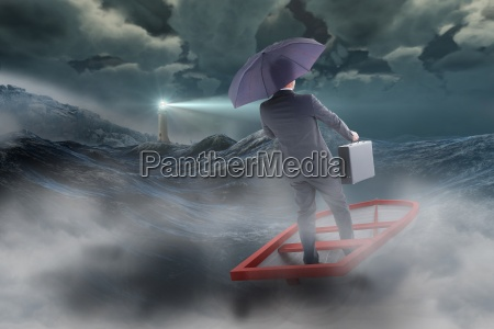 composite image of businessman in boat