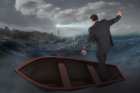 composite image of businessman balancing in