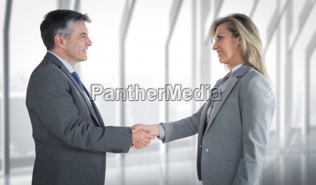 composite image of pleased businessman shaking