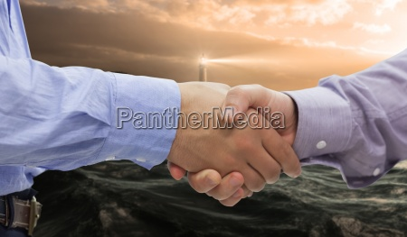 composite image of two men shaking