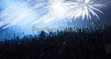 huge cheering crowd at concert