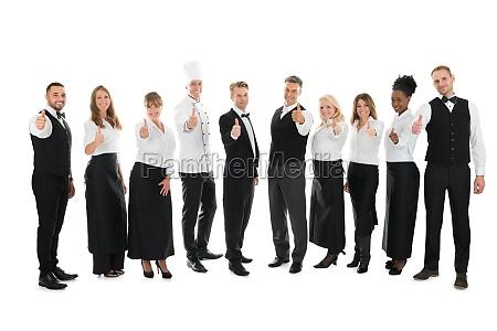 portrait of confident restaurant staff standing