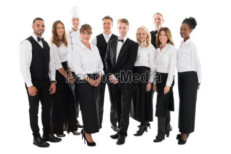portrait of confident restaurant staff standing