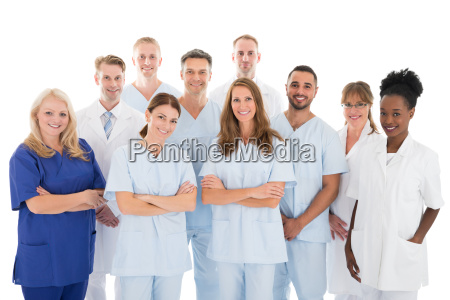 happy medical team standing against white