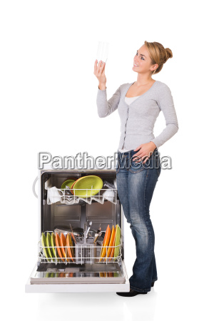 woman looking at clean glass while