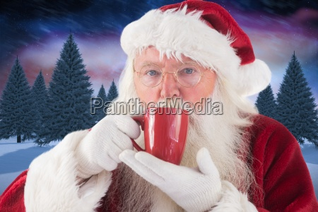 composite image of santa drinks from