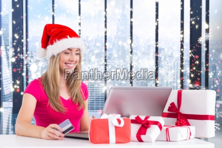 composite image of festive blonde shopping