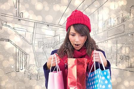 composite image of shocked brunette opening