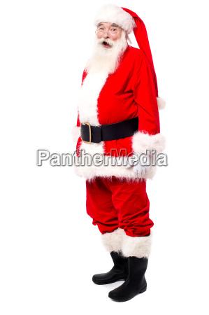 old man in santa dress posing