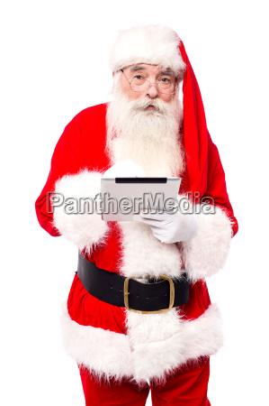 old man in santa dress using