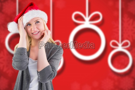 composite image of festive blonde smiling